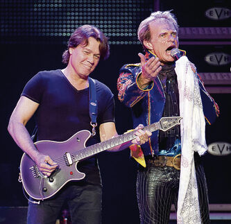 Eddie Van Halen (left) and David Lee Roth perform with aging rock band Van Halen at the MTS Centre Sunday night.