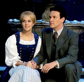 "This image released by NBC shows Carrie Underwood, left, as Maria, and Stephen Moyer as Captain Von Trapp during preparations for ""The Sound of Music Live!, in Bethpage, N.Y. The live production airs on Dec. 5 at 8 p.m. EST. (AP Photo/NBC, Paul Drinkwater)"