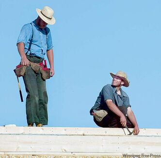 KEN GIGLIOTTI / WINNIPEG FREE PRESS  / Aug. 30 2006 - 060830 - Bill Redekop story - First Amish settlement outside of Ontario  being built  just south of Plumas and north west of Gladstone - in pic Amish workers   working on roof of church -  kgamish opens all 7 photos