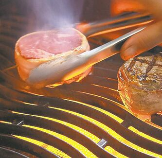 Steaks cook on a grill. Learning how to grill steak is an important skill to get the best result.With outdoor grilling season around the corner, there is no better time to become educated on steak buying and grilling. THE CANADIAN PRESS/ HO