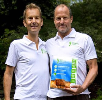 Jeff Golfman and Woody Harrelson, along with Clayton Manness (not pictured), are co-founders of Prairie Pulp & Paper Inc., whose wheat-straw-based paper was found to have the lowest environmental impact compared to other copy paper.