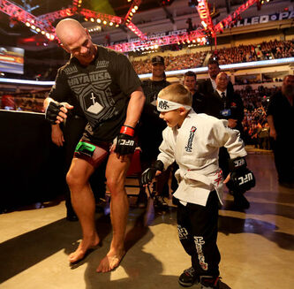 Ryan Jimmo does the robot with Avery Kelleher, 6, following Jimmo's victory over Igor Pokrajac, during UFC 161 in Winnipeg Saturday.