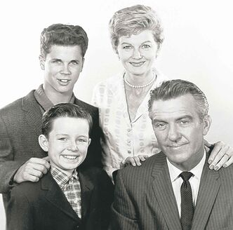 The Cleaver family (clockwise from bottom left): The Beaver (Jerry Mathers), Wally (Tony Dow) June (Barbara Billingsley) and Ward (Hugh Beaumont) on Leave it to Beaver.