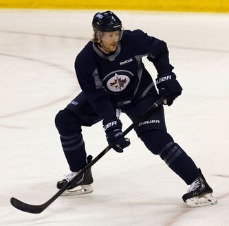 Pre Game feature , Winnipeg Jets  defence  Paul Postma  #4 prepares  for game vs. The Boston Bruins at the MTS Centre Thursday.