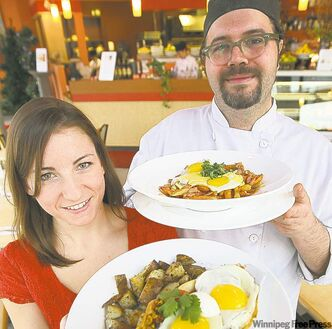 Dessert Sinsations sous chef Mike Ozero holds egg poutine as server Kate McFee holds huevos rancheros.