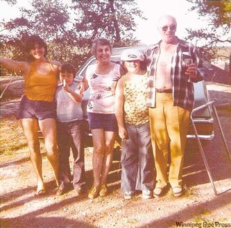 That's our little Willy pointing his imaginary gun at the camera with his mother, Isabelle, brother Allen and grandparents Molly and Maurice LeBrun.