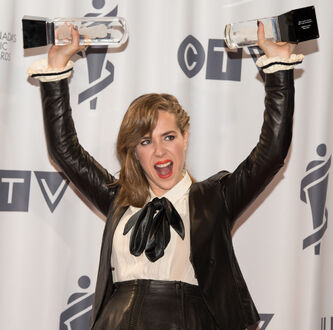 Serena Ryder with her two JUNOs, Songwriter of the Year and Artist of the Year, at the 2014 JUNOs at the MTS Centre in Winnipeg on March 30, 2014.