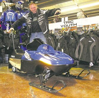 Dave Radey with a Yamaha 120 snowmobile.