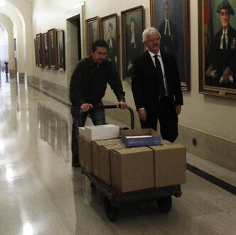The Phoenix Sinclair Inquiry report is delivered in boxes to the Legislative Building committee room for reporters to review.