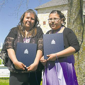Melody Harper (left), daughter Kalvina saved two children from drowning.