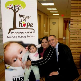 Minister for Children and Youth Opportunities Kevin Chief (at right) with Hunger for Hope client Pam Harper and her niece Alizaya. Hunger for Hope is looking to the public to help them out, as the program is facing a $100,000 shortfall.
