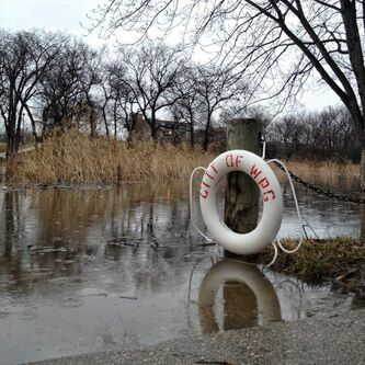 The bridge at Omand's Creek is under water as levels rise on the The rising Assiniboine River begins swelling Omand's Creek on Tuesday morning.