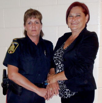 Social Worker Cindy Willette and Constable Linda Parsons of Winnipeg Police - Victim Services encourage Westwood neighbours to honour their emotions and to reach out to overcome trama.