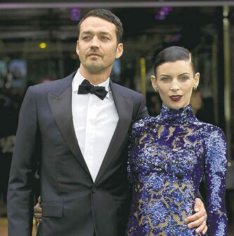 CORRECTS DATE OF DIVORCE FILING TO FRIDAY, JAN. 25 - FILE - In this May 14, 2012 file photo, actress Liberty Ross with director Rupert Sanders pose for the media at the World Premiere of the film,