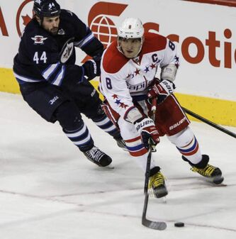 Winnipeg Jets defenceman Zach Bogosian is in hot pursuit of Alexander Ovechkin of the Washington Capitals during an NHL game at the MTS Centre on Thursday.