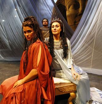 Aida (from left), played by Michele Capalbo, Radames, played by Rafael Davila, and Amnevis, played by Tiziana Carraro.