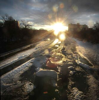 The sun rises over a thawing Assiniboine River in Winnipeg Thursday morning.
