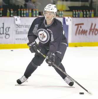 Josh Morrissey, the team's first pick in the 2013 NHL draft, readies to fire.