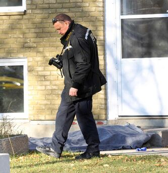 Winnipeg Police Forensics investigate the area around King Street and Stella Walk. The medical examiner has arrived on the scene to investigate a body that was found.