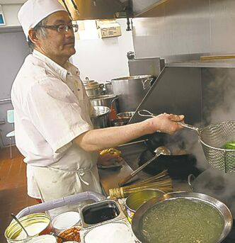 Chef Bai Rong Shen at work in the kitchen.