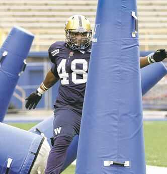 Youri Yenga,  an import defensive end on Winnipeg's practice roster, goes through  his paces  during a Tuesday morning practice at Canad Inns Stadium.