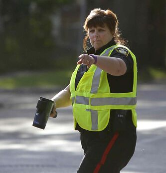 Winnipeg police Const. Karen McCowan pulls over a motorist on McDermot Avenue that was exceeding the new 30 km/h speed limit near Ecole Sacre Coeur School Tuesday morning.