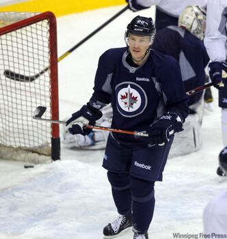 "Winnipeg Jets"" new winger Antti Miettinen skates at practice Monday."