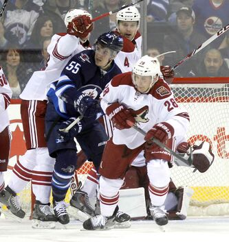 Winnipeg Jets Mark Scheifele gets ambushed by a pack of Phoenix Coyotes. Winnipeg Jets game at MTS Centre.