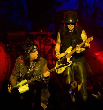 Nikki Sixx (left) and Mick Mars of Motley Crue perform at the MTS Centre in January, 2010.