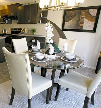 A great-room design incorporates the living room, dining area and kitchen into a large, integrated space.