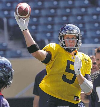 Quarterback Drew Willy fires the football at practice Tuesday.
