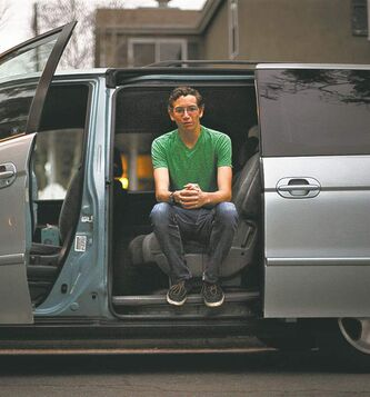 "Christian Kerr, 16, of Long Beach, California, with his family's Honda Odyssey. Kerr is one of a growing number of teenagers who are in no hurry to learn to drive. ""Getting a licence just isn't a priority,"" he says."