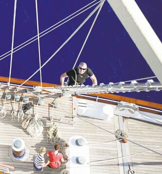Stephen MacNauill climbs the fore mast of the Star Clipper while sailing from Mykonos to Kos, Greece.