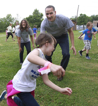 Jill dodges Kevin Chief, Children and Youth Opportunities Minister and Jenna Millar, Senior Activity Leader at Camp Manitou as the minister began his community outreach program. Manitoba government funding will reach more than 60,000 children and youth this summer including 15,000 through the Green Team Program which creates summer employment opportunities for youth aged 15 to 29 years.