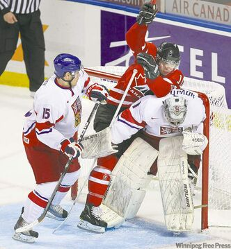 Canada's Brayden Schenn wreaks havoc in the Team Czech crease, plowing into goalie Filip Novotny.