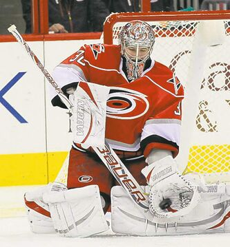 Carolina Hurricanes Cam Ward (30) makes a stop during the first period of an NHL game against the Boston Bruins at PNC Arena in Raleigh, North Carolina, Monday, January 28, 2013. (Chris Seward/Raleigh News & Observer/MCT)