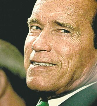 Austrian born actor and former Governor of California Arnold Schwarzenegger smiles during the Delhi Sustainable Development Summit, in New Delhi, India, Thursday, Feb. 2, 2012. World leaders, environmentalists and experts from across the globe attended the summit to prepare a roadmap for attaining sustainable development worldwide. The 12th edition of the summit organized by The Energy Research Institute (TERI), was inaugurated by Indian Prime Minister Manmohan Singh. (AP Photo/Manish Swarup)