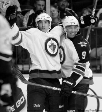 Jets right-winger Spencer Machacek celebrates with Evander Kane (9) after scoring against the Nashville Predators on Saturday.