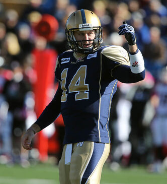 Winnipeg Blue Bombers' quarterback Joey Elliot (14) gives signals from the line of scrimmage during the first half of CFL football action against the Calgary Stampeders' at Canad Inns Stadium, Saturday, October 13, 2012.