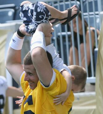 Backup QB Max Hall plays with three-year-old son Rex during Wednesday's practice at Investors Group Field.