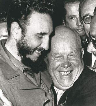 Soviet Leader Nikita Khrushchev (right) hugs Cuban Leader Fidel Castro in 1960 photo.