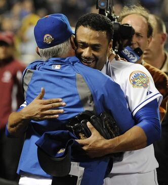 New York Mets starting pitcher Johan Santana, right, hugs manager Terry Collins after throwing a no-hitter against the St. Louis Cardinals in a baseball game on Friday, June 1, 2012, at Citi Field in New York. The Mets won 8-0.