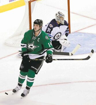 Ondrej Pavelec stones Stars captain Jamie Benn in the shootout.