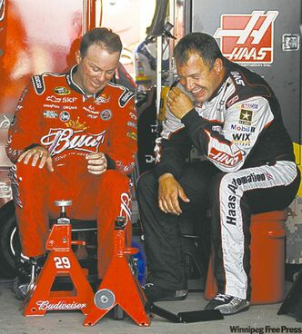 Drivers Kevin Harvick (left) and Ryan Newman were getting along fine Friday.