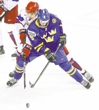 Russian defenceman Mikhail Naumenkov (left) tries to reach around Swedish  forward Sebastian Collberg, a potential first-rounder.