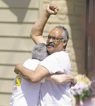 Felix DeJesus celebrates after bringing home his daughter, Gina, Wednesday.