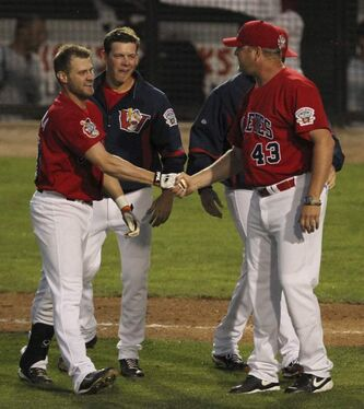 Josh Mazzola is congratulated by manager Rick Forney after his home run in the Winnipeg Goldeyes' 5-4 win over the St. Paul Saints on Thursday.