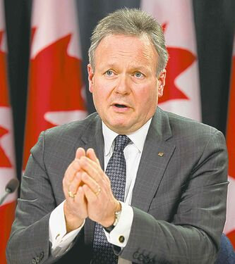 Bank of Canada Governor Stephen Poloz speaks with the media following an interest rate announcement, Wednesday January 22, 2014 in Ottawa. THE CANADIAN PRESS/Adrian Wyld