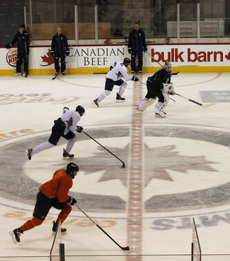 The team goes through a blue-line-to-blue-line drill at Wednesday's strenuous workout in the MTS Centre.