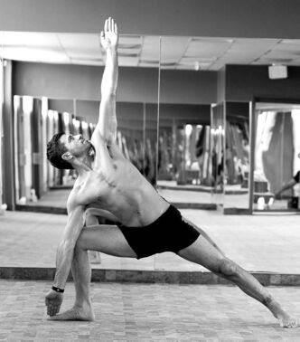 Yoga student Don Fata, show in the triangle pose, will compete in the regional yoga competition on April 29.